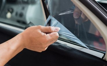 56485341 - car window tinting series : removing old film